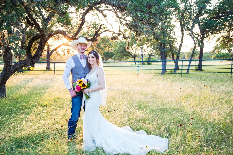 Bride and groom cowboy hat sunflower bouquet