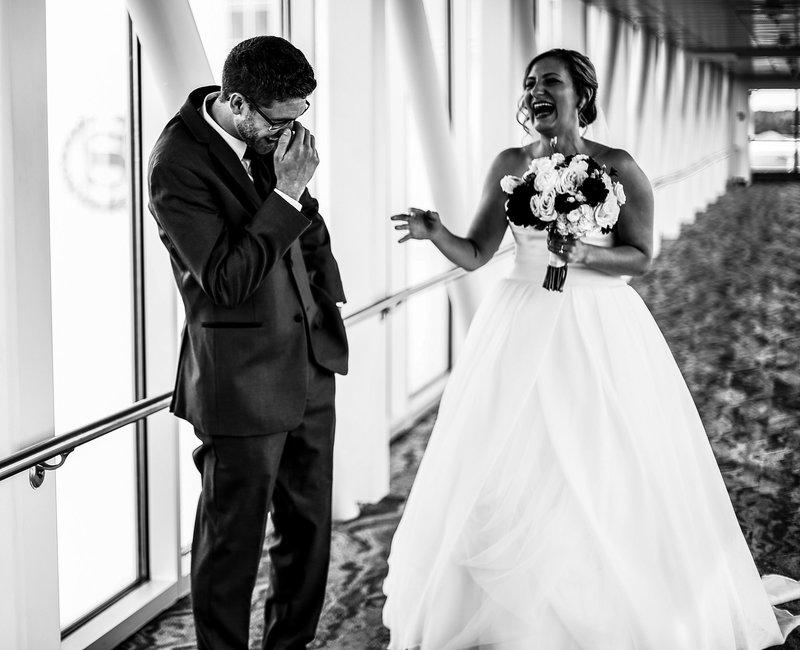 Groom sees his bride during first look on the skybridge at the Sheraton Erie Bayfront Hotel