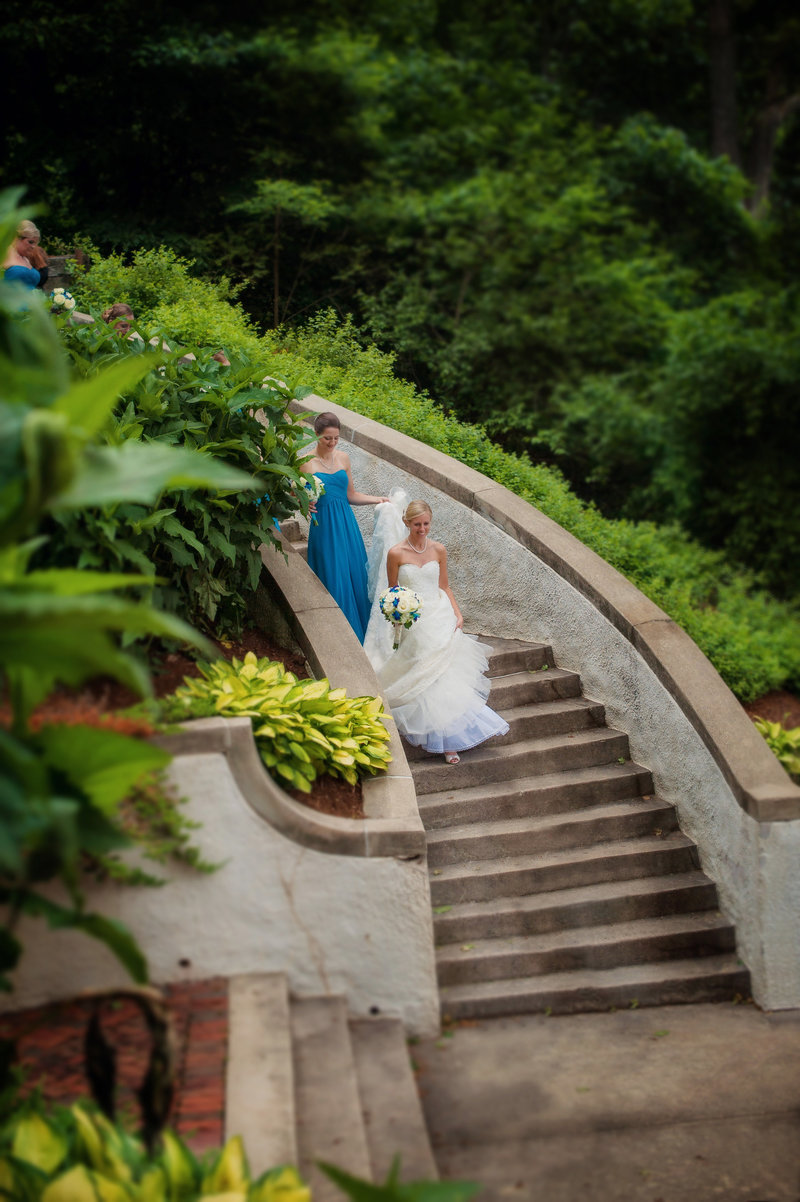 Lake park Milwaukee photo with bride and bridesmaid on stairs.