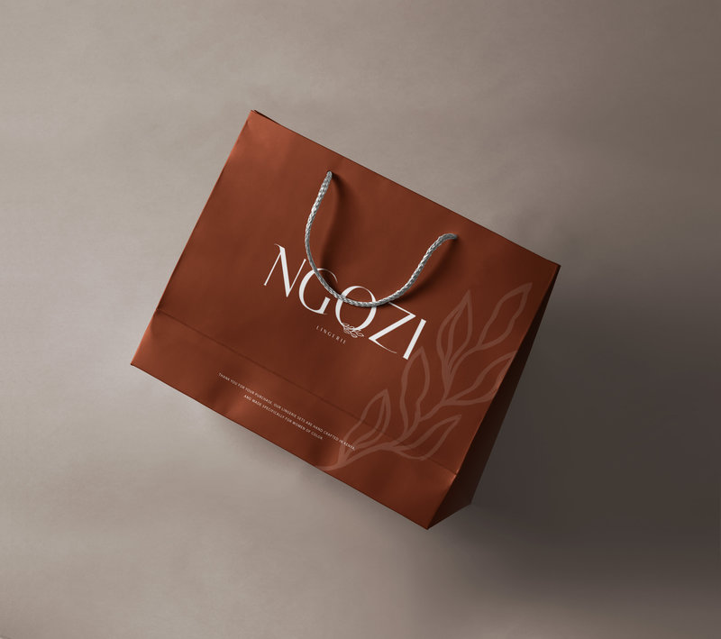 Merlot Colored shopping bag created for NGOZI, branding done by Ile Alafia Design Co in Miami FL