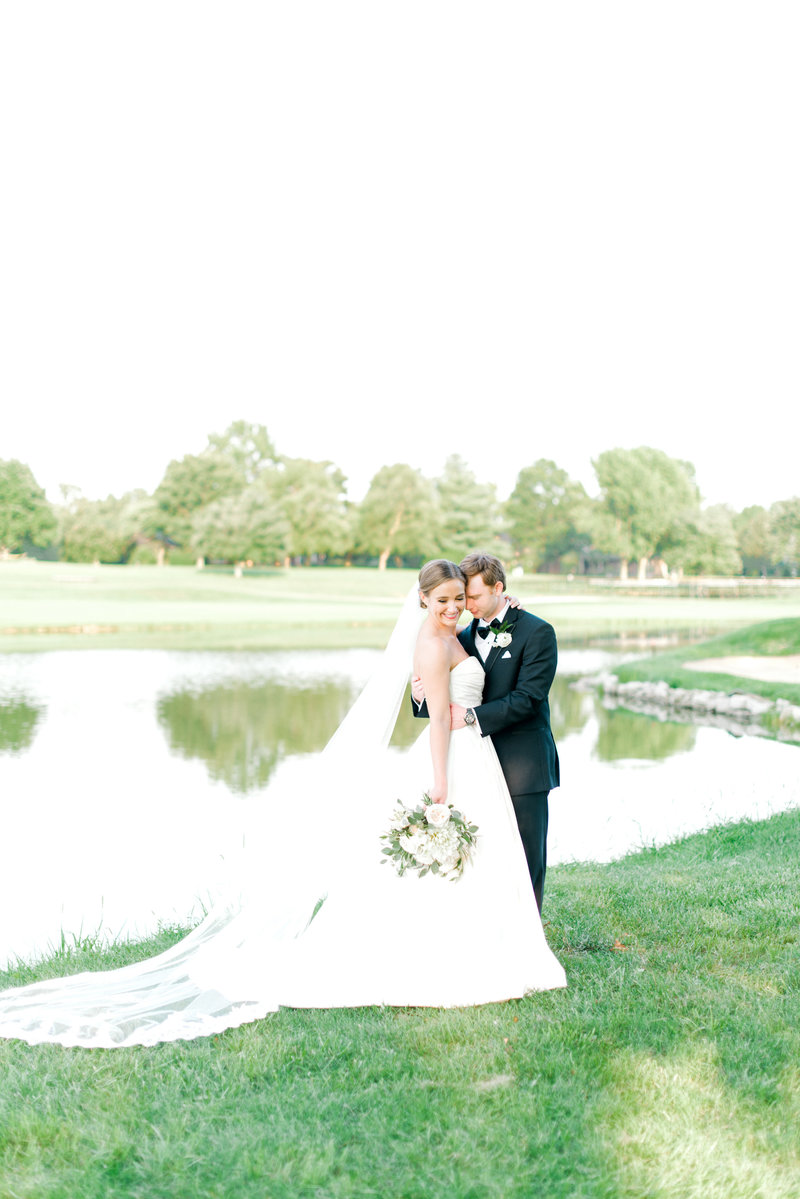 Bride and Groom embrace at Keene Trace Golf Club, Lexington Kentucky Wedding Photographer, Katelyn V. Photography
