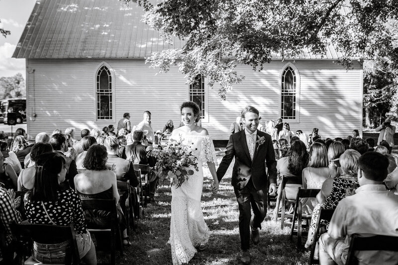 Melissa and Matthew walk from their ceremony as husband and wife in Franklin, Tennessee.