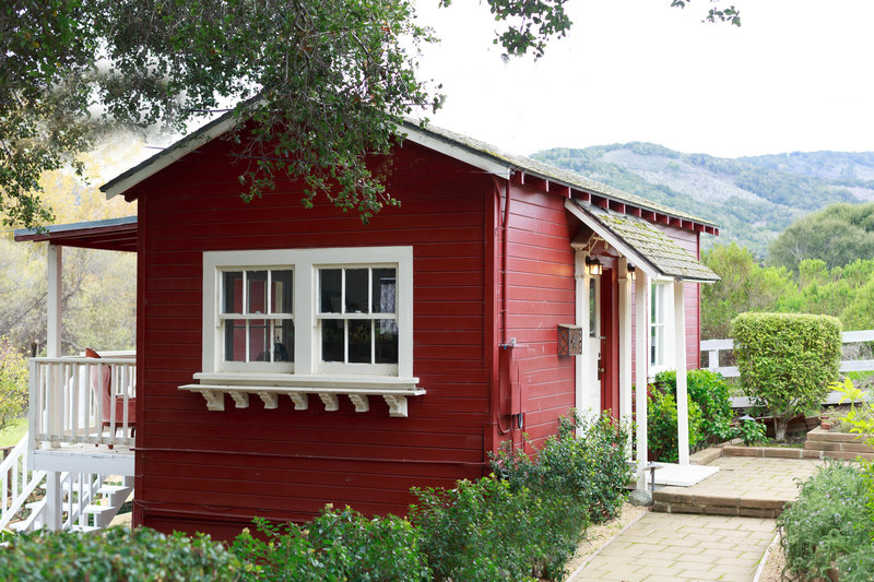 ags photo art wedding photographer office located in Carmel California red cute cottage with white shutters in the valley of Carmel california.