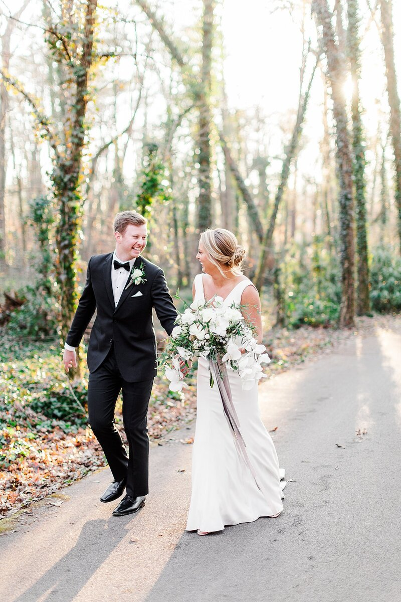 bride and groom holding handsby Knoxville Wedding Photographer, Amanda May Photos