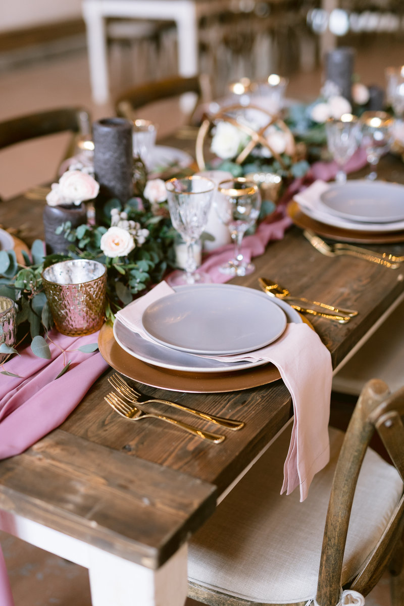 Luxurious touches added to the bridal table using gold silverware.