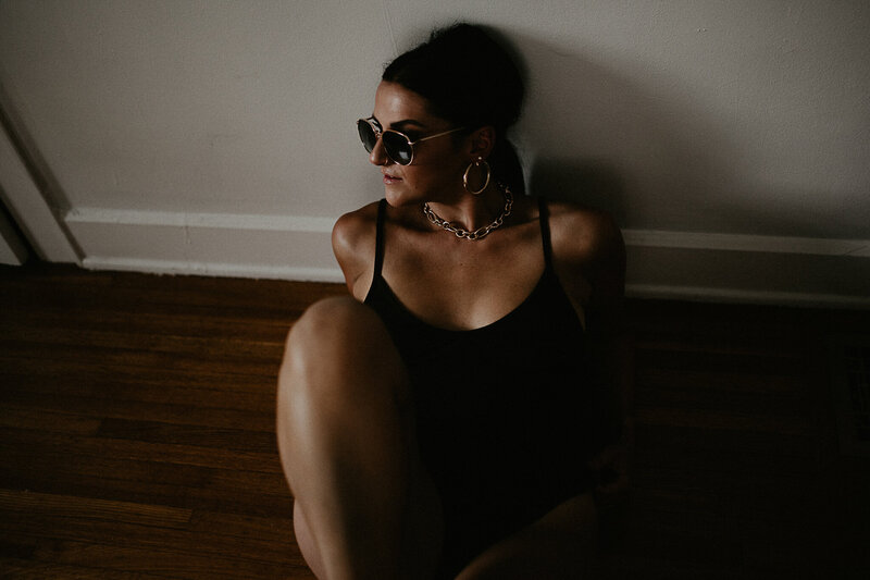 Woman in sunglasses during an Indianapolis boudoir session.