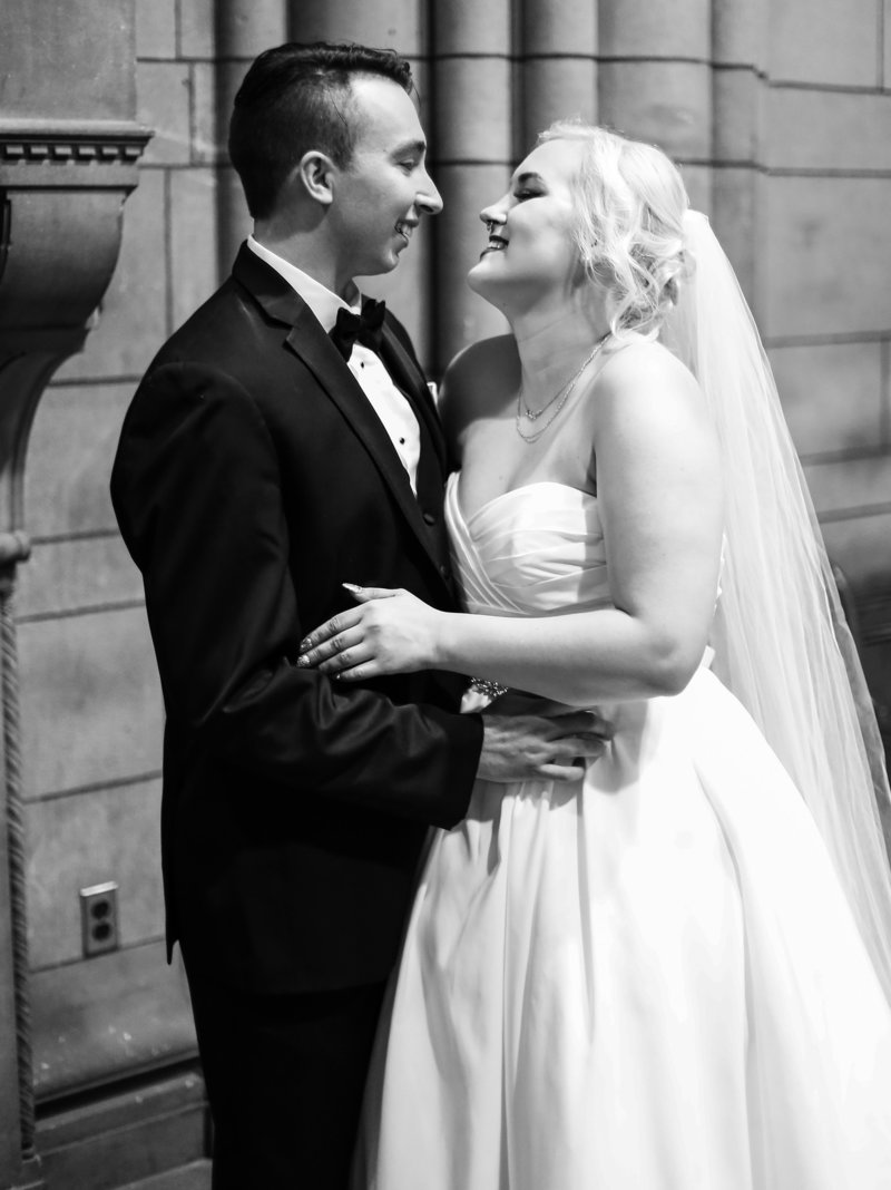 Wedding couple pose for a portrait inside the Cathedral of Learning in Pittsburgh, PA
