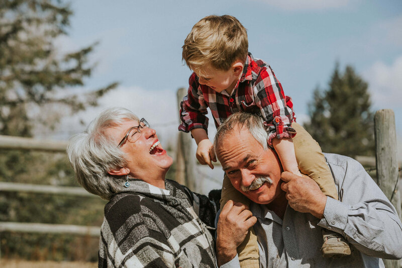 grandparents laughing with grandson