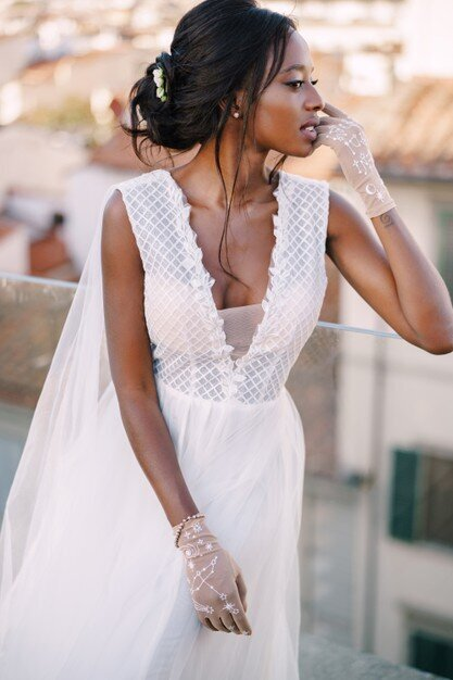 beautiful-african-american-bride-white-wedding-dress-touches-her-face-vintage-gloves_278455-91
