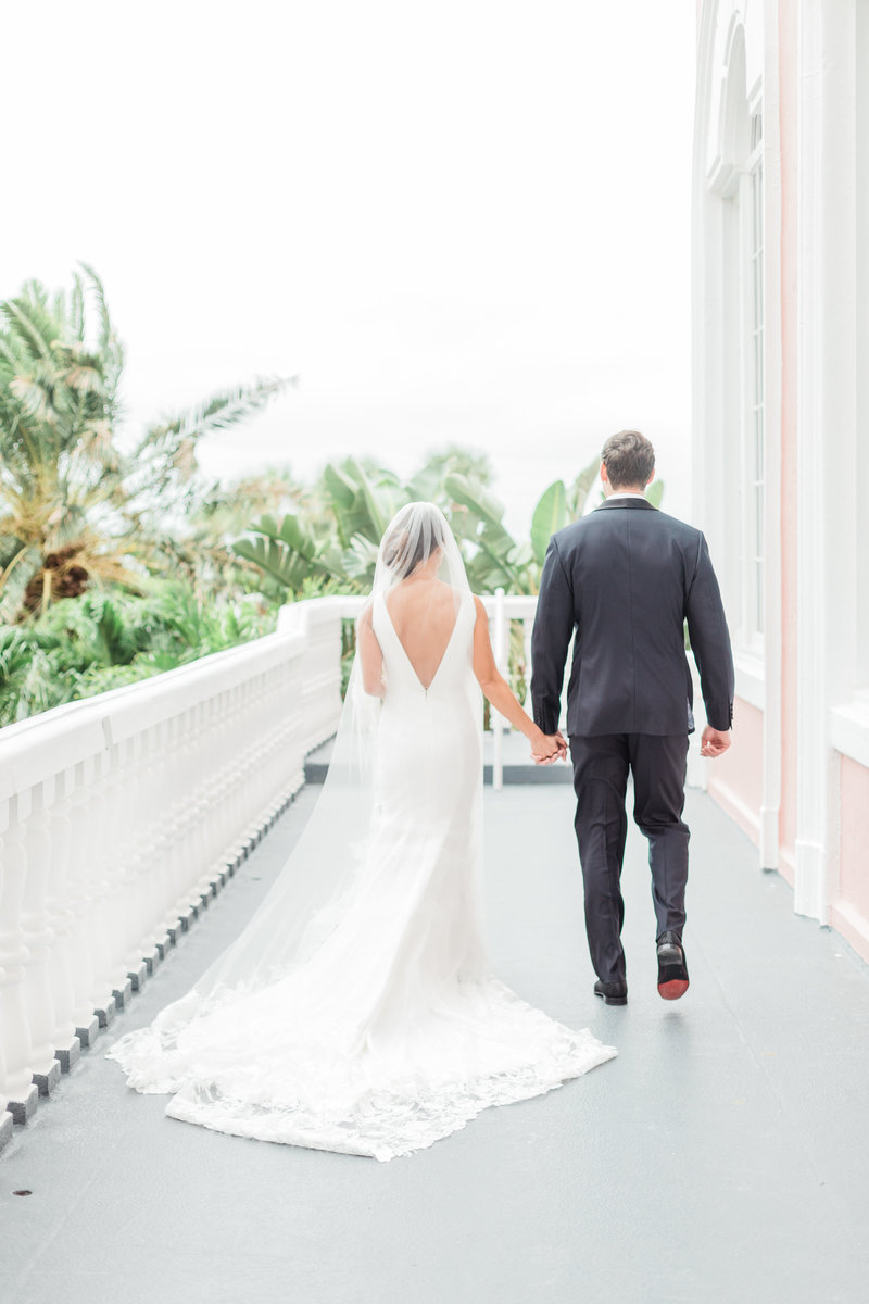 first look on balcony at Don Cesar Wedding Photographer in St. Petersburgh Florida by Costola Photography