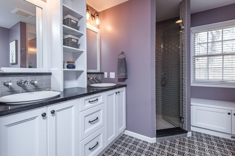 grey and white bathroom with patterned tile