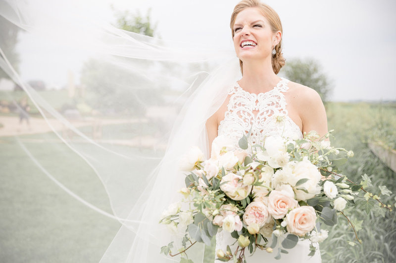 Bride with bridal bouquet and veil at Legacy Hill Farm in Welch Minnesota