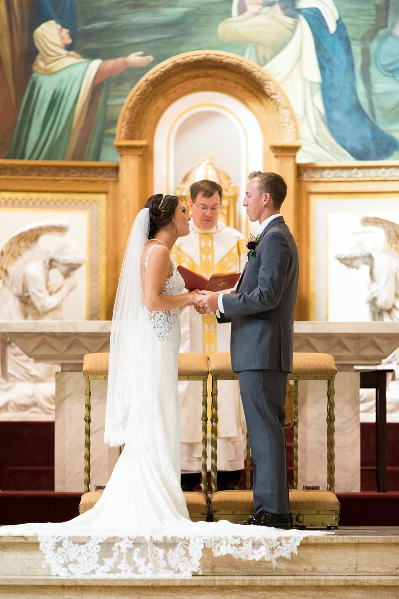 bride and groom on altar in downtown detroit catholic wedding