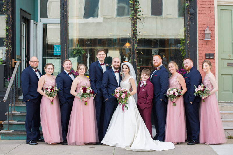 pink and navy bridal party outside cityflats ballroom port huron