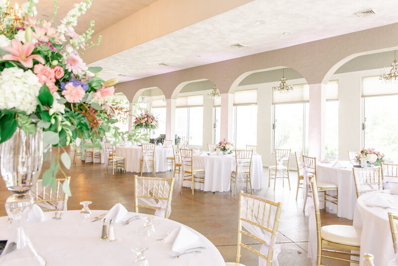 An elegant reception with large floral arrangements at Herman Hill.