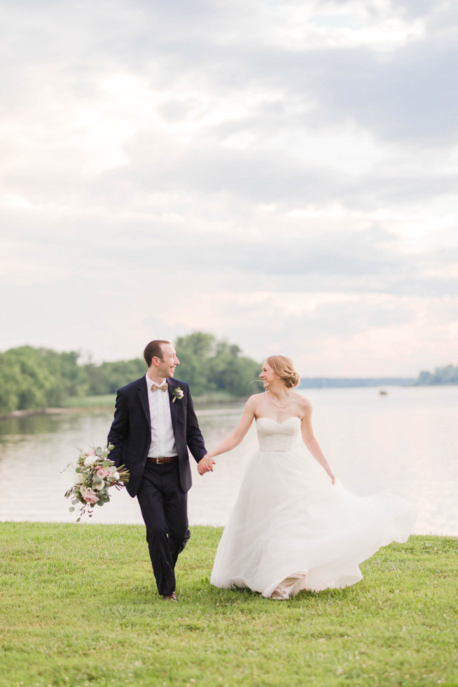 couple walking by the bay at eastern shore wedding at kirkland manor by costola photography
