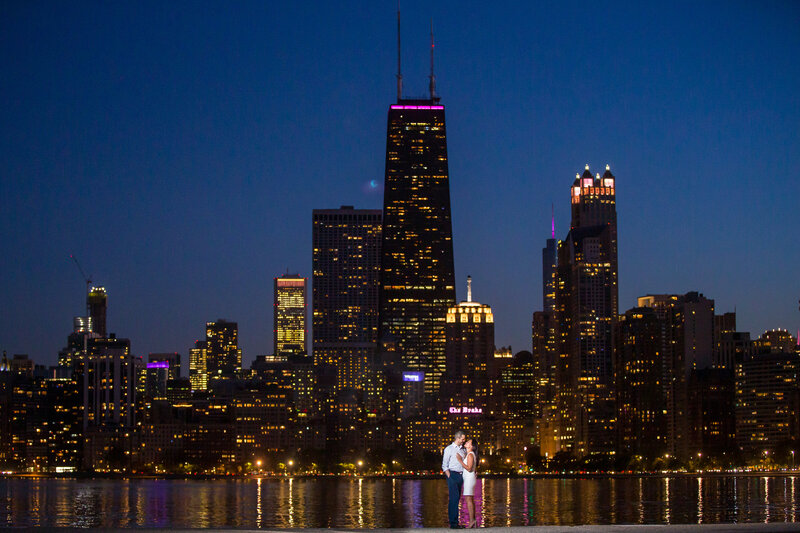A breathtaking wedding photo of the Chicago skyline at night.