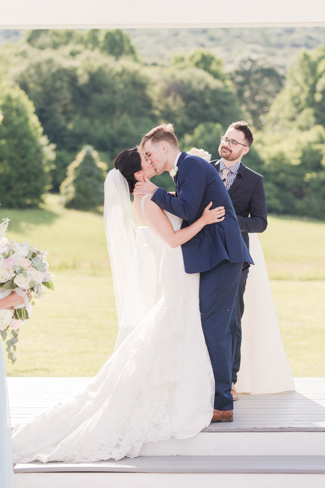 first kiss as husband and wife at springfield manor winery and distillery wedding by costola photography