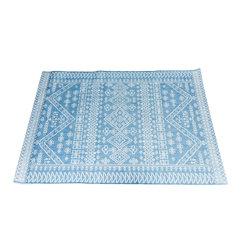 Outdoor rug with Moroccan pattern.