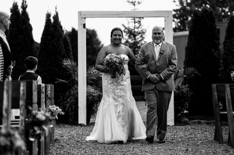 Bride walking down the aisle with her father at Port Farms wedding