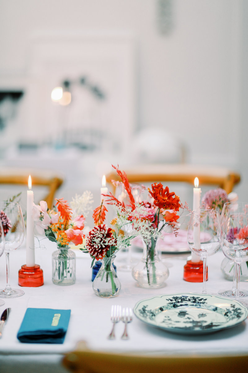 A destination film wedding photographer captures a bright and creative wedding tablescape.