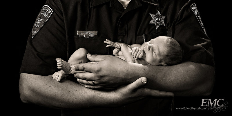 Newborn baby in father's arms