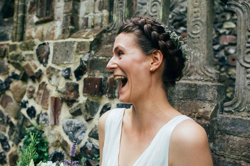 Laughing relaxed bride by Emily Tyler Photography in Suffolk