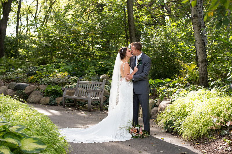 bride and groom kissing at detroit garden center