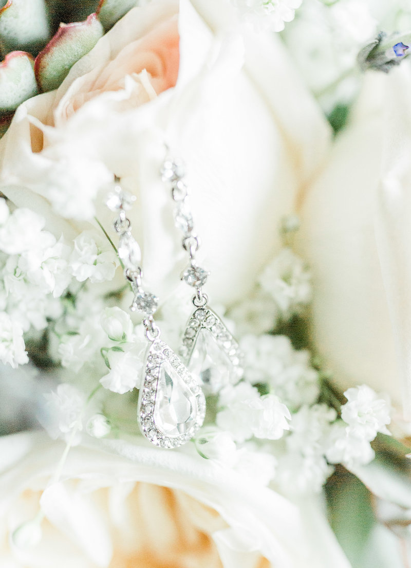 bridal earrings on wedding bouquet