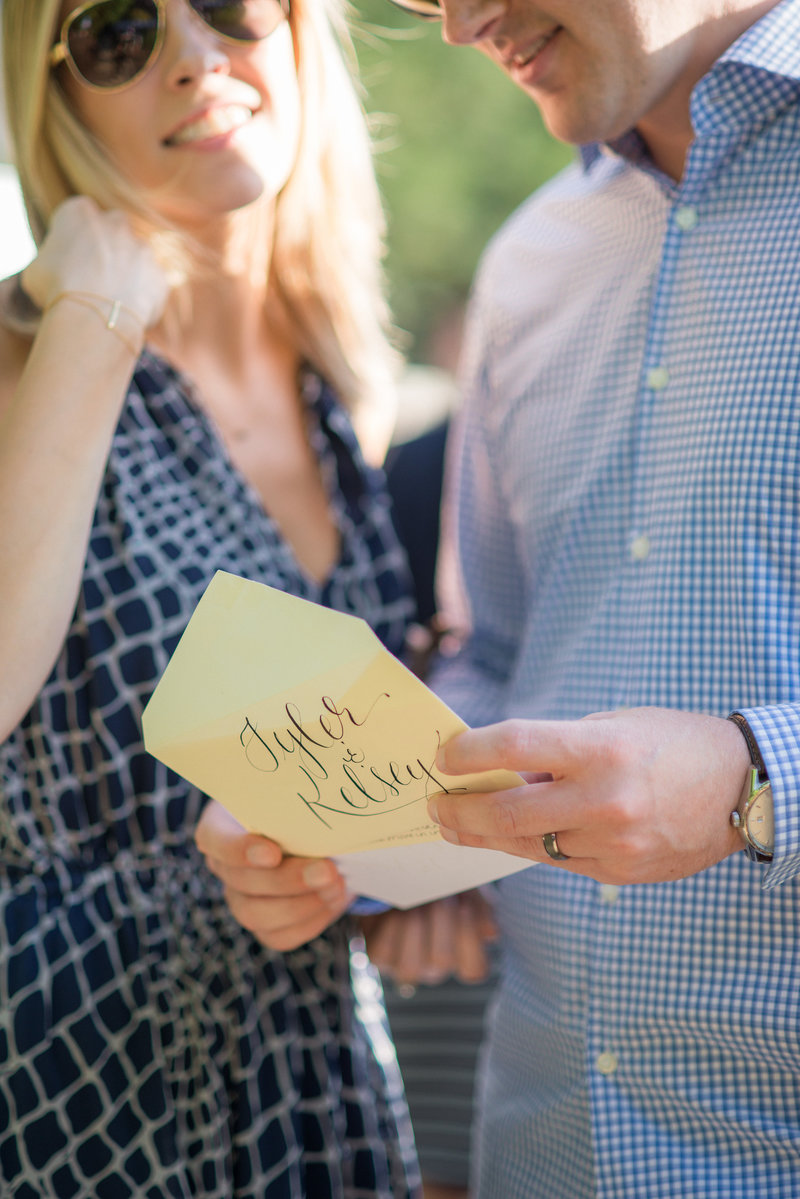 Couple reading card at engagement party by Jenny Schneider Events.