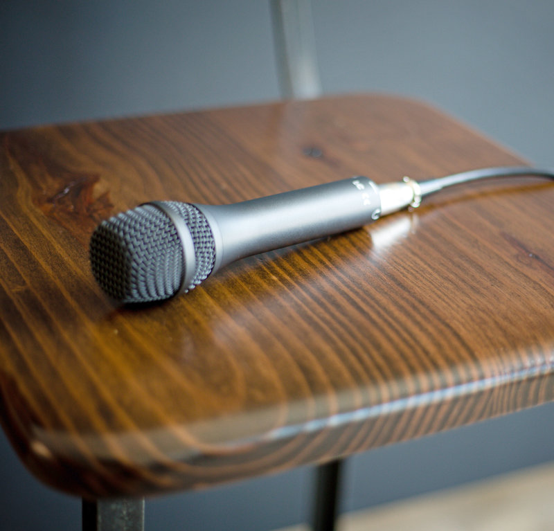 picture of microphone laying on a wooden chair