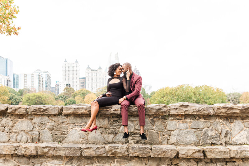 A black couple at their engagement session at Piedmont Park in Atlanta Georgia by Jennifer Marie Studios, top Atlanta wedding photographer.