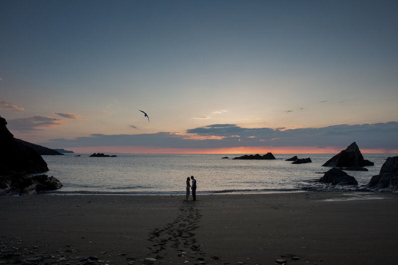 Sunset wedding photo at Tunnels Beaches Devon