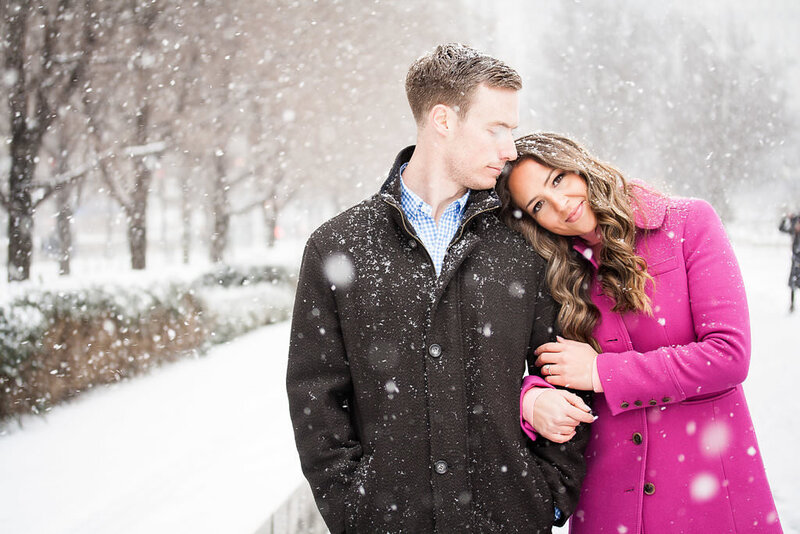 couple hold hands during detroit winter engagement session