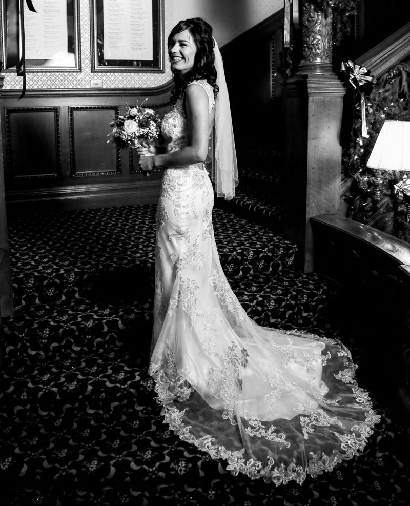 Solo portait of bride on the stairs at Gannon University's Old Main