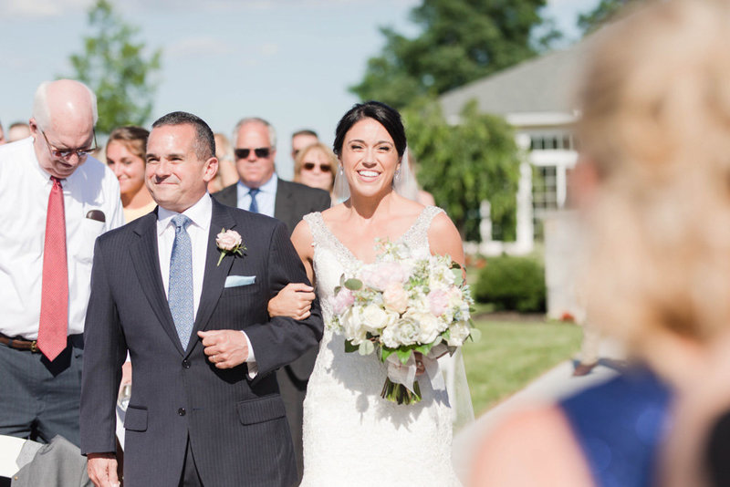 bride walking down the aisle with father at springfield manor winery and distillery wedding by costola photography