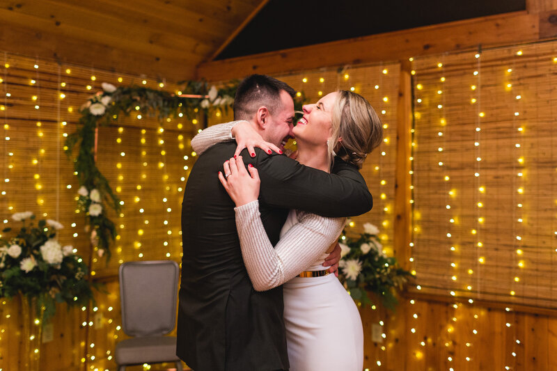 bride and groom embracing and laughing during first dance ohio wedding