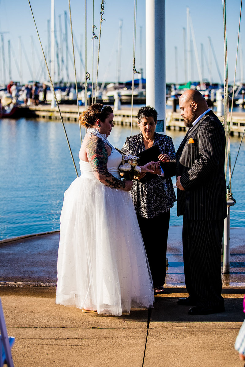 Couple exchanging rings at an Erie Yacht Club wedding