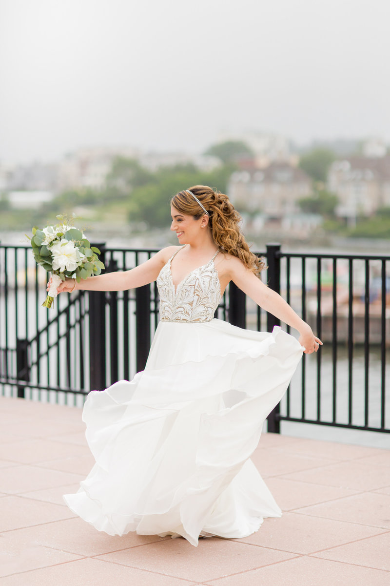 Bride twirling in Hayley Paige dress by JLM Couture
