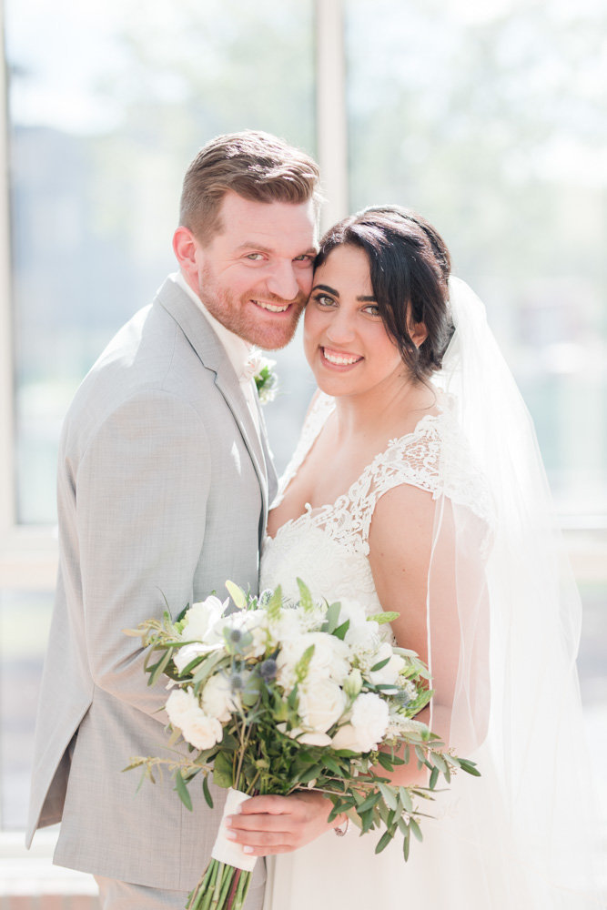 bride and groom smiling  at Stone House at Stirling Ridge Maryland Wedding by  Costola Photography