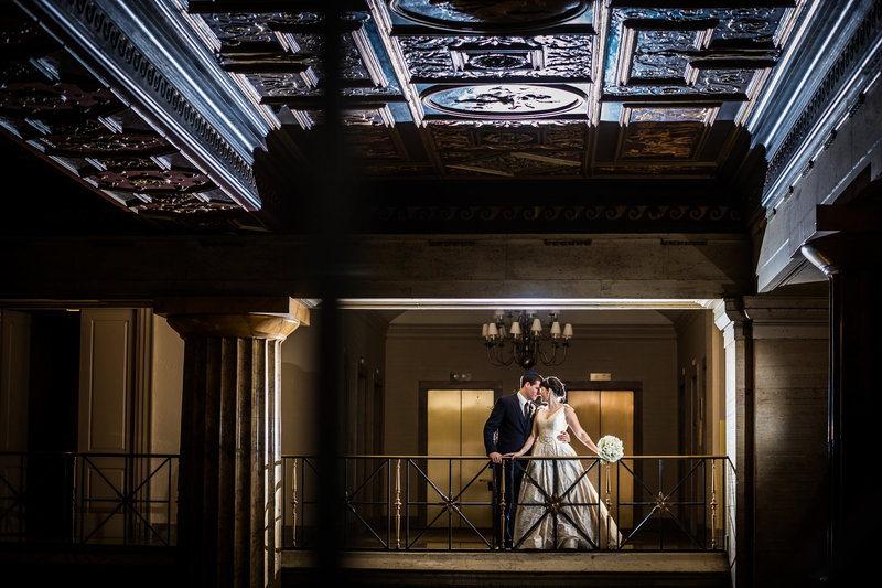 Bride and groom dramatic light portrait at ballroom at the ben philadelphia PA
