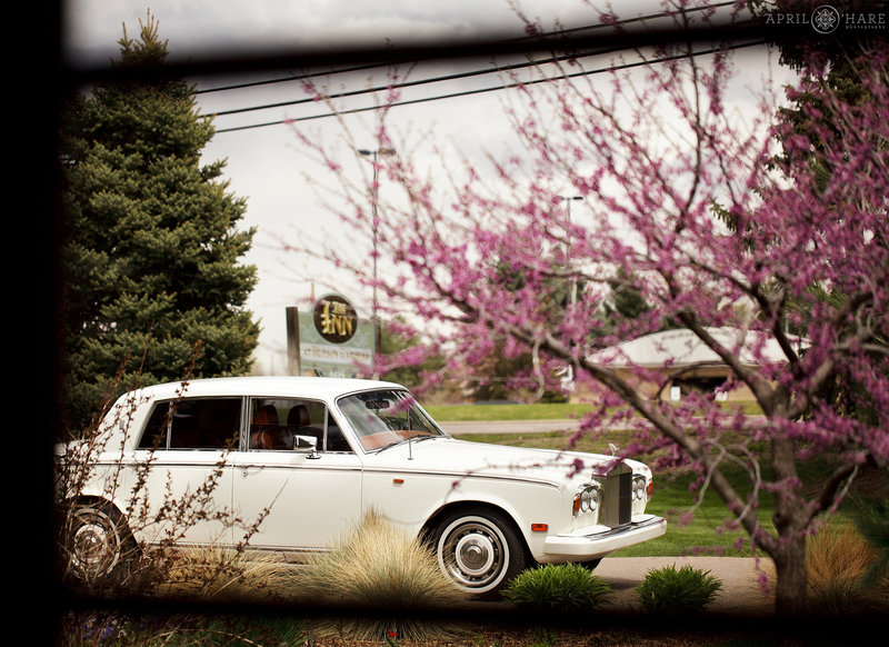 Fancy Rolls Royce waits at  a Spring wedding at the Inn at Hudson Gardens