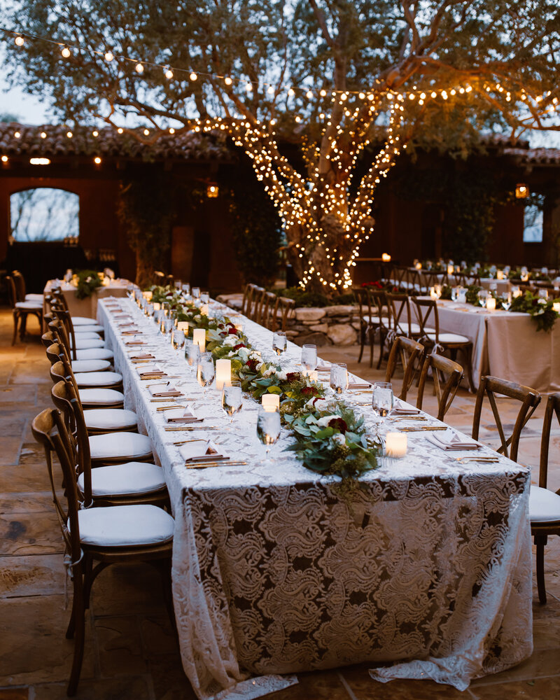 A wedding reception is set on a lace tablecloth in Spain.