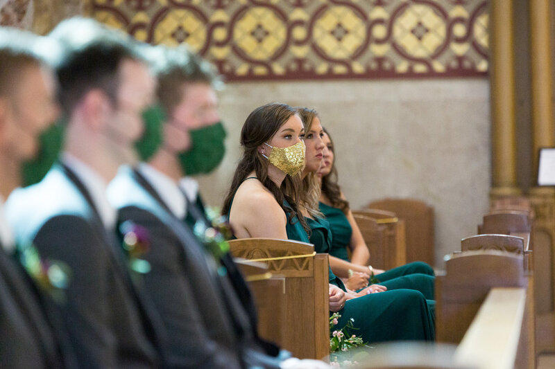 bridesmaids wearing covid masks in downtown detroit catholic wedding