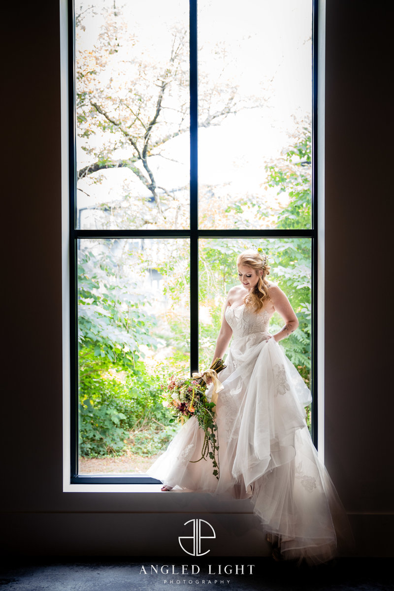 bride standing in window