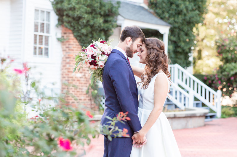 Bright and airy wedding portrait of a bride and groom at the Hazlehurst House in McDonough Georgia by Jennifer Marie Studios Atlanta light and airy wedding photographer