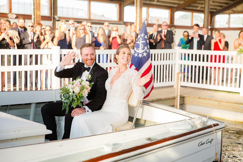 Couple leaving ceremony on a boat ride