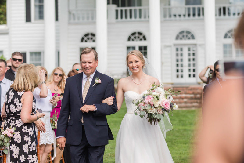 bride and father walking down the aisle during ceremony at eastern shore wedding at kirkland manor by costola photography