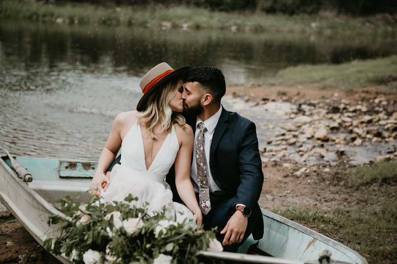 elopement in a boat with flowers