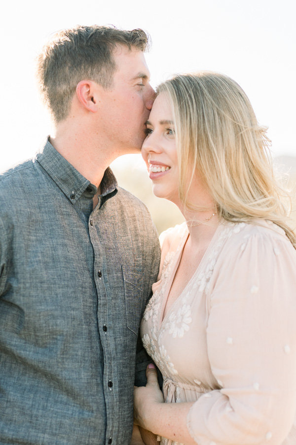 Tucson Desert Engagement Session Photo of Couple Hugging at Gates Pass | Tucson Wedding Photographer | West End Photography